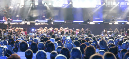 assists crowd standing at a concert - 230659067