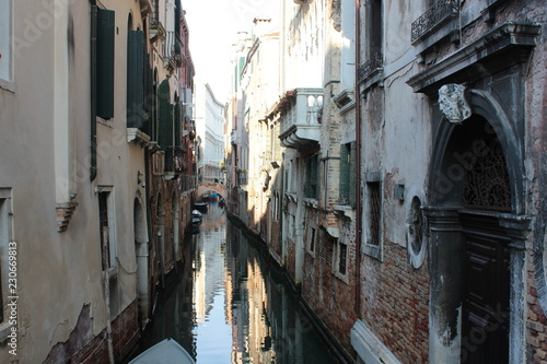 The canal in Venice. Ancient buildings, bridges, boats, reflections in the water - 230669813