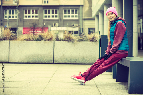 Woman wearing sportswear exercising outside during autumn - 230677002