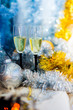 couple.  glasses with sparkling white wine on the background of a New Year's shiny decor