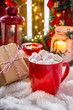 Christmas holiday arrangement.  Cup with hot cocoa marshmallows with candles, gifts, a cozy fluffy blanket.  concept of peace and comfort at home in Christmas. New Year winter background greeting card