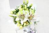 Beautiful bouquet of light green eustoma, chrysanthemum and white lilies