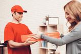 Arab Deliveryman Gives Pizza Box Smiling Girl. - 230692464