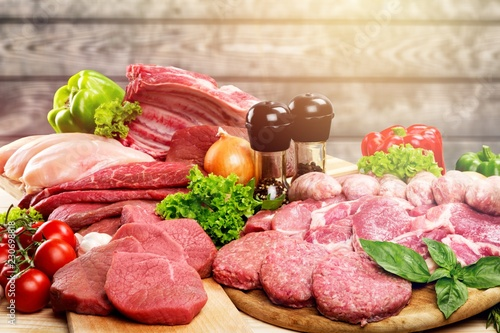 Fresh Raw Meat Background with vegetables, meat concept, butcher © BillionPhotos.com