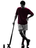 one caucasian field hockey player man isolated silhouette on white background - 230701600