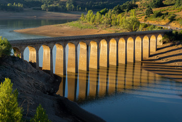 Bridge over Requejada reservoir, mountains of Palencia, Spain © NoraDoa