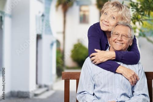 Leinwanddruck Bild Portrait of happy senior couple smiling at home