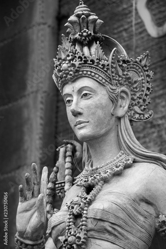beautiful marble of women statue in traditional indonesian attire