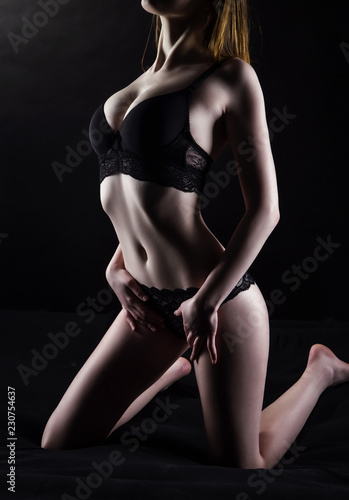 Leinwandbild Motiv Photo of hot girl in black lingerie
