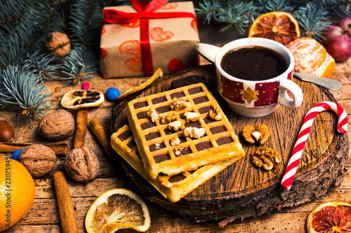 Leinwandbild Motiv New Year and Christmas treats and sweets. Waffles and cookies with decorations