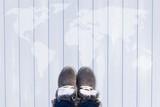 Grey fashion shoes on world map background - 230761804