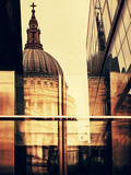 St Paul's Cathedral, London, UK. Reflected in the tinted windows of a modern building