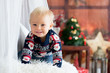 Leinwanddruck Bild - Little baby toddler boy, playing with christmas decoration at home