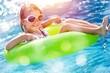 Leinwandbild Motiv Beautiful little girl sunning at the pool