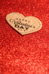 Red glistening background, the redditch with the text of the happy St. Valentine's Day