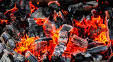 Burning coals of wood as a background - 230838837