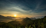 Unseen mountains sunrise from Phutathan viewpoint, Phangnga, Thailand.