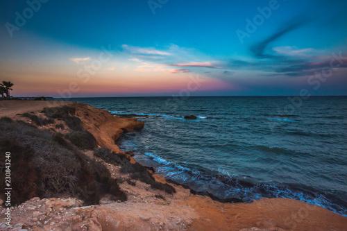 Leinwandbild Motiv Landscape shot of Mil Palmeras seashore in the evening, Spain