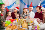 family celebrating children's birthday during festive dinner - 230860424