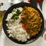 Basmati rice with curry from vegetables and lentils. Healthy spicy vegan food. - 230875067