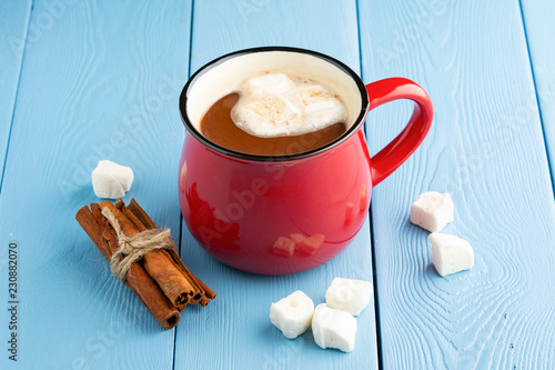Poster red mug with hot cocoa or chocolate with cinnamon sticks and marshmallows