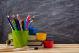 school supplies on the background of a blackboard - 230883682