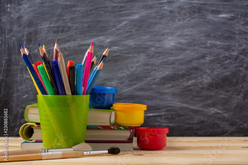 school supplies on the background of a blackboard