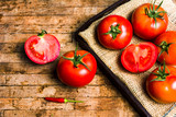 Tomatoes on a rustic wooden table - 230886642
