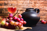 Fresh grape and homemade wine on a table
