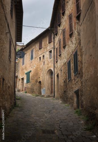 View of narrow street in Italian town, Tuscany, Italy.
