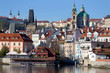 Colorful autumn Prague St. Nicholas' Cathedral with the Lesser Town above River Vltava in the sunny Day, Czech Republic