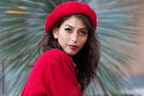 Foto Murales Beautiful, stylish woman wearing red beret and matching sweater