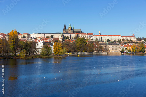 Colorful autumn Prague gothic Castle and Charles Bridge with the Lesser Town in the sunny Day, Czech Republic - 230913473
