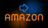 Amazon - orange glowing text with an arrow on dark background
