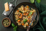 pumpkin farfalle pasta with pumpkin seeds and cheese in bowl