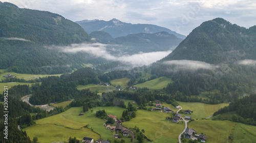 Aerial view of the morning foggy landscape in the alpine mountains