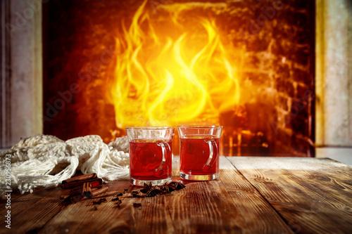 Leinwandbild Motiv Mulled wine on a wooden table in a winter scenery