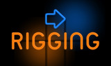 Rigging - orange glowing text with an arrow on dark background - 230958834