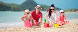 Family making sand castle at tropical beach - 230960286