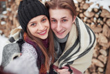 Happy Young Couple in Winter Park having fun.Family Outdoors. - 230966641