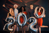 A group of beautiful young people celebrating the new year. - 230967077