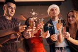 A photo featuring a group of friends who have fun with snowmen and champagne. Happy New Year. Close up. - 230967403