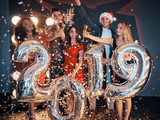 Beautiful young friends, having fun on New Year's Eve, holding numbers for 2019. - 230967621