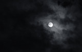 Full moon with dark clouds in the night sky