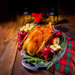 festive stuffed roast goose with red cabbage and dumplings - 230971660