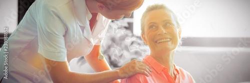 Leinwanddruck Bild Female nurse consoling senior woman