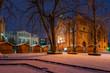 Leinwanddruck Bild - Uzhgorod, Ukraine - DEC 26, 2016: Feczik Park in winter at dawn. former building of synagogue is a popular tourist attraction. location for Christmas fair in town