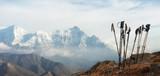 Trekking sticks on background mountains range. Panoramic view.