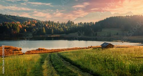 Leinwandbild Motiv Wonderful Foggy sunset over the lake in mountans.