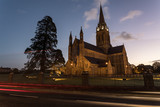 St. Mary's Cathedral in killarney during dawn sunrise, Car light streaks diving by